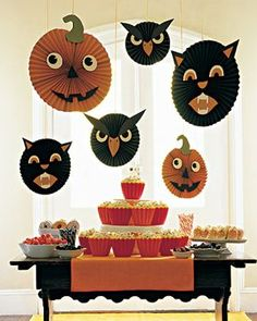 Retro Halloween table display idea. Hey, popcorn and popcorn balls are a great idea! Hanging lots of inexpensive honeycomb crepe paper decorations is easy and makes a BIG IMPACT!