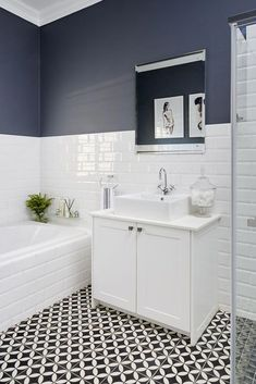 Jo'burg interior designer Kelly Adami, brought a tired bathroom up to date. This tired bathroom updated with a monochromatic scheme. White Bathroom Tiles, Bathroom Layout, Modern Bathroom, Bathroom Ideas, Simple Bathroom, Bathroom Cabinets, Bathroom Organization, Condo Bathroom, Relaxing Bathroom