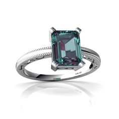 Alexandrite ring, nice baguette cut in an extremely simple setting. See more natural green color could be a resetting of an older stone. I still like it.