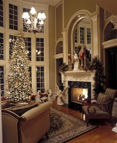 French inspired castle house plan is wonderfully dressed in holiday cheer. View over 50 photographs of this just over 4,000 square foot luxury estate. http://www.thehousedesigners.com/plan/pontarion-ii-6002/