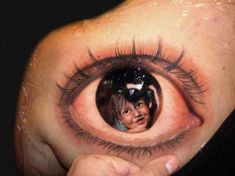 Child's Portrait in Reflection of Eye Tattoo