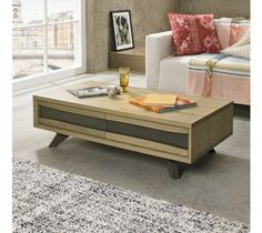The Cadell Aged & Weathered Oak Coffee Table with Drawer boasts organic lines and finely tapered weathered oak legs. Displaying a split panel design front with waved edges in knotty aged oak and contrasting weathered oak inlay, this coffee table is the epitome of retro inspiration, modern elegance and will blend in perfectly into any living space.