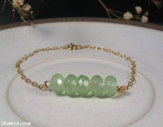 Find Delicate gold filled bracelet with green stones
