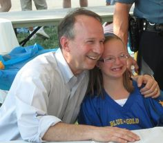 Governor Markell with an excited fan prior to DFRC's Blue Gold All Star Game.  DFRC is dedicated to raising funds and consciousness in support of programs that enrich the lives of Delawareans with intellectual disABILITIES.