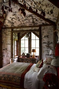 Fairytale Hideaway: Celerie Kemble's Adirondack Mountain house guest room with birch bark wallpaper