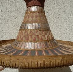 Rare basket headdress with mica inlay and painting, fabric, from Suluwesi Indonesia late 19th c (archives sold Singkiang)