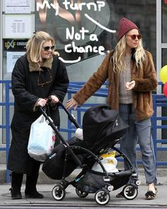 Sienna Miller takes her baby Marlowe and her mom Jo for a walk in NYC.