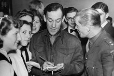 21st April 1943: Uniformed comedian Tommy Trinder (1909 - 1989) giving his autograph at a Home Guard celebration. (Photo by M. McNeill/Fox Photos/Getty Images)