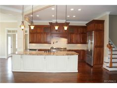 Love the white island with the darker cabinets