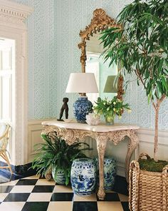 Lattice wallpaper creates a garden-like backdrop for the ornate console and mirror in this entry. | Photographer: Amy Neunsinger