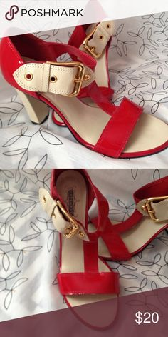 Stellablu red heels Bright red patent leather heels with bold cream and brass buckle. Chunky heel that is in for this season. Stellablu Shoes Heels