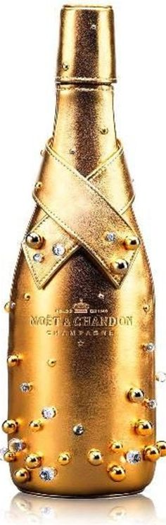 The Moet & Chandon Limited Edition 'Midnight Gold' case is a case designed specifically to chill bottles of Moet & Chandon and is made of lambskin covered with gold and decorated with hand-sewn swarovski crystals and gilded pearls, which draws it's inspiration from Champagne Bubbles. -ShazB