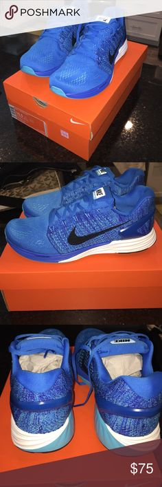Brand New in box Men's Nike Lunarglide 7 Blue white and black swoosh. Brand new. My husband has a bad shoe habit. He loves crossfit and think he has to own hundreds of shoes. Nike Shoes Athletic Shoes