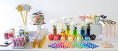 Amy Atlas via Kelly Allison Photography. Such a great idea for vases with colored water.