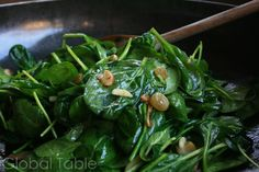 Andorran Salad: warm spinach, mushrooms, almonds, and golden raisins.