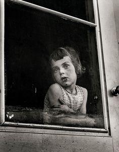 Erika Stone, Child behind screen door, Canada, 1956.