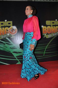 Lovely Ankara Turtle Neck Gown For The Queens