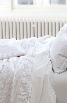 Fresh white linens are a must in my bedroom. I love the smell of freshly bleached/laundered sheets. It makes me feel clean & put together even if the rest of my life isn't so organized.
