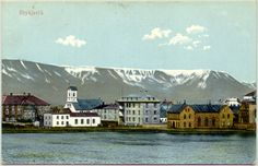 An old Icelandic postcard with an image from downtown Reykjavik (Iceland's capital), and Mount Esja in the background. The building on the far left is the House of Parliament, and the church is Reykjavik Cathedral.