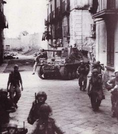 6 August 1943 - German troops start pouring in to take over Italy's defenses - 11 August - German and Italian forces begin to evacuate Sicily - German paratroopers with Panzerjäger Marder in Italy
