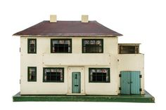 A Tri-ang Dolls' House No 45, painted cream with green tinplate and cellophane windows, turquoise front door and garage door, long balcony across front, sun room on garage roof (possibly from another house), red/brown painted roof, front opening to reveal four rooms, fireplaces and stairs, electrically-lit and triangular label on back, circa 1939 -- 31¾in. (80.5cm.) wide (G, some wear)