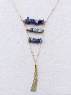 Gold Tassel necklace framed by layers of Sodalite and Pyrite stones on gold 30 inch chain. Handmade on Etsy by CaitLizLee. Long layering necklace.