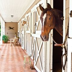 Horse Stable Turned Cottage | The horse stalls are off the kitchen, making a daily ride part of life here.