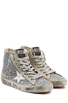 Nothing short of statement, these Golden Goose sneakers are accented with sparkling glitter and a white leather star. All of the brand's signature detailing remains, from the distressed midsole to the logo detail on the side #Stylebop