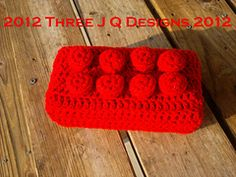 Ravelry: Lego Brick pattern by Tara Quarles.  A pillow for your blockheads...ha!