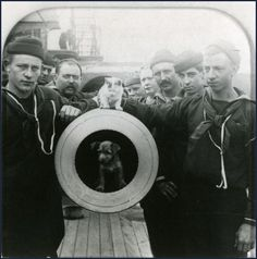 Crewman of USS Texas pose with mascot dog and cat on the muzzle of one of the ship's guns, ca Built in Texas was the first US battleship and gained a reputation for being jinxed because of a series of accidents. Uss Texas, Pearl Harbor Day, Us Battleships, The Spanish American War, American History, Weird Vintage, Navy Ships, Dog Cat, This Is Us