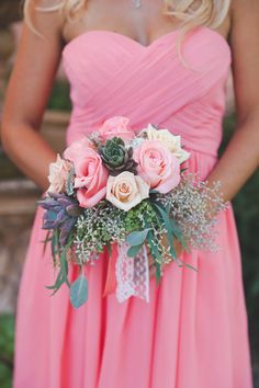 A gorgeous bridesmaid wrapped in pink that matches her beautiful bouquet! {Abbey Lunt Photography}
