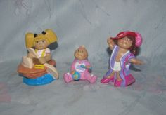 Vintage Cabbage Patch Kids Small PVC Figures - Set of 3 - Playing Dressup, Baby Eating, and Camilla Paddling a Walnut Shell by pollypocketplus on Etsy https://www.etsy.com/listing/462029437/vintage-cabbage-patch-kids-small-pvc