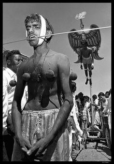 "The ""Bird Man"" of Penang, at a Thaipusam festival."