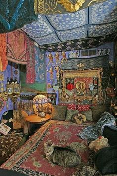 Tiny Joe, a plump tiger cat, curls up on Ostrozovich's bed. The cat seems to blend in with the bedroom's swirl of color and texture.(FRANK ESPICH)