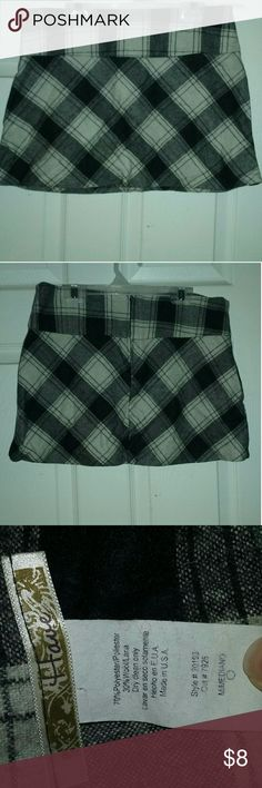 "Plaid mini skirt Black, white and grey plaid mini skirt.  Waist 15.5"" length 13"".  Zips down the back. 70% poly 30% wool. Have Skirts Mini"