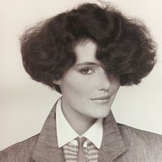 1980s hair, I remember the high school girls wearing their hair like this, with skinny pants above their ankles and white Keds and sweaters 3 sizes too big