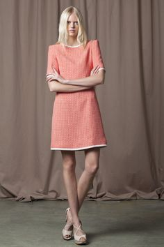 Orange and white mix, knee-length dress with high neck and 3/4 length sleeves