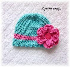 Newborn Baby Girl Crochet Ruffled Flower Hat Blue and Pink. $9.95, via Etsy.