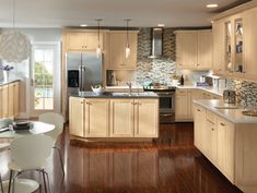 natural maple kitchen cabinets | Kitchen example displaying the Armstrong cabinet style Trevant with ...