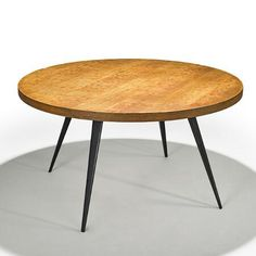 Charlotte Perriand; Oak and Enameled Steel Dining Table for Ateliers Jean Prouve, 1950s.