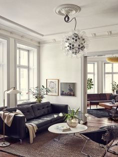 Prop stylist Joanna Lavén's home in Stockholm mixes traditional and modern ceiling fixtures and medallions