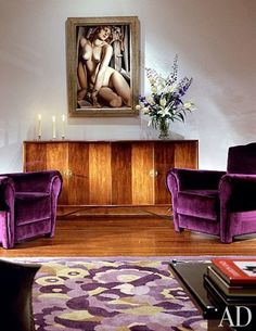 A circa 1930 sideboard by Eugène Printz features one of his signature design motifs—accordion-folded doors. Andromeda, 1929, by Tamara de Lempicka and a pair of late-1930s American club chairs are grouped in another area of the living room.