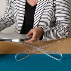 Laptop stand - Looks like something I need to invest in for work