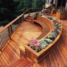 A deck with different layers and a curved seating area.