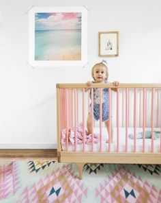 Em Scott, a designer in San Francsico, never dreamed she'd base her daughter Charlie's nursery on the color pink. Then she came across this rosy crib and ended up decorating around its blushing loveliness. (via Parents.com) #nursery #style #decor #ideas