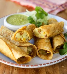 Potato taquitos! Fresh mashed potatoes, garlic, spices and bacon fill these fried corn tortillas. Use corn kernels instead of bacon to make them vegetarian. These are super fast if you have leftover mashed potatoes and kids love them. Serve with sour cream, guacamole, or just salsa.