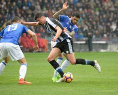 Stipe Perica (C) of Udinese Calcio compete with Leonardo Bonucci (L)  and Daniel Alves Da Silva (R) of Juventus FC during the Serie A match between Udinese Calcio and Juventus FC at Stadio Friuli on March 5, 2017 in Udine, Italy.