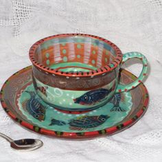 Vivid Cup And Saucer with swimming fish by pamdesign on Etsy