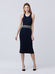 This bodycon shift dress with a flattering racer-back is versatile and chic. It has a back slit for added movement. Belt not included.