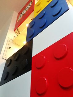 How to Build LEGO-themed Shelves With Display Areas...Totally Awesome!  I so want to to this for my son's room this summer.  When he is older, we can adjust doors and still  use shelving space IF he outgrows Legos!! :)